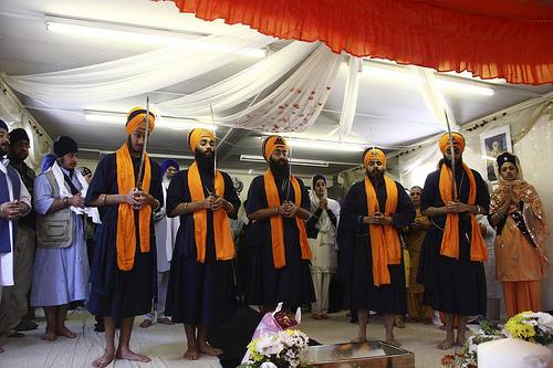 Sikhs worshiping.